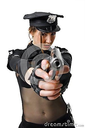 Beautiful policewoman aiming a gun