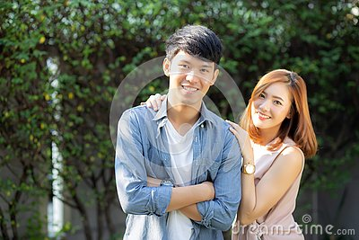 Beautiful portrait couple looking each others eyes and smiling with happy, young asian man and woman relation with love dating Stock Photo