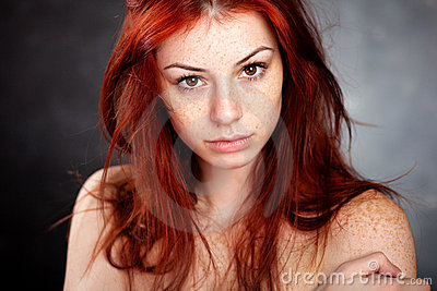Beautiful portrait with red hair and freckles