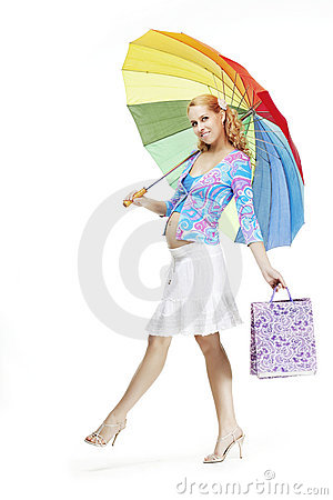 Beautiful pregnant girl with a rainbow umbrella