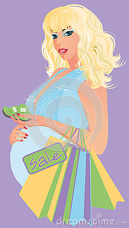 Beautiful pregnant woman  with baby socks