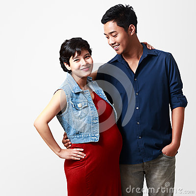 Beautiful pregnant woman and her husband