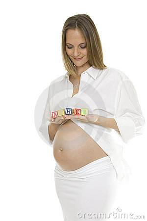 Beautiful Pregnant Woman Holding Baby Blocks