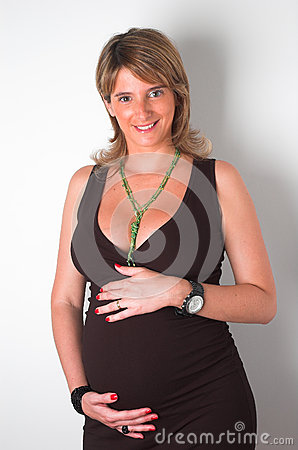 Beautiful pregnant woman holding her belly
