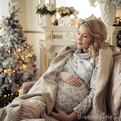 Free Beautiful Pregnant Woman In Comfy Clothes. Royalty Free Stock Photo - 79364865