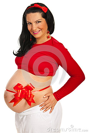Beautiful pregnant woman with red bow