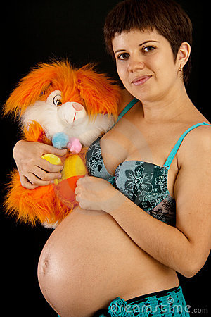 Beautiful pregnant woman with a toy