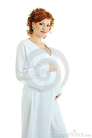 Beautiful pregnant woman in white