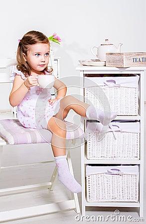 Preschool girl with tea cup