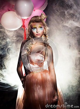 Beautiful Princess in Pink Dress with Golden Crown. Haze