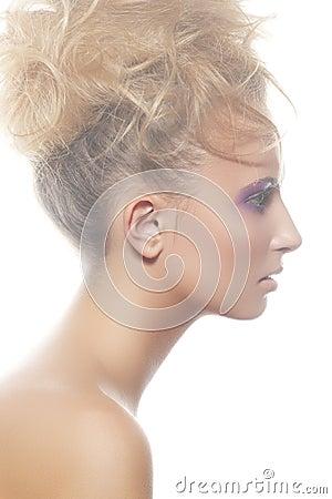 beautiful profile woman model with bun hairstyle stock
