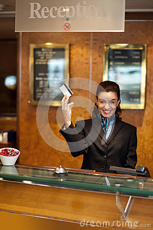 Beautiful receptionist posing with cash card