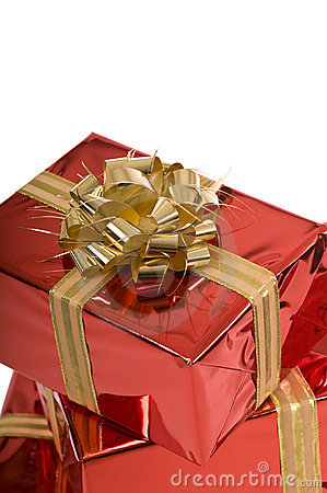 Beautiful red Christmas gifts with gold bow
