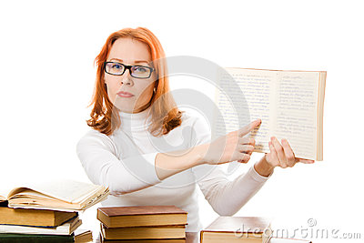 Beautiful red-haired girl in glasses with books