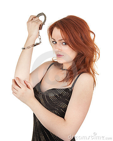 Beautiful red-haired girl in handcuffs