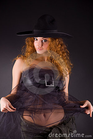 Beautiful red-haired girl in hat