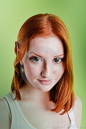Beautiful red-haired girl in a role of elf