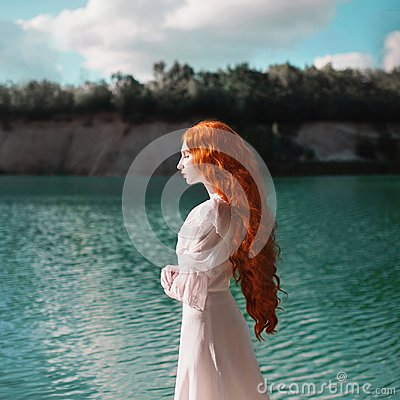 Free Beautiful Red-haired Woman In A Luxurious Renaissance Dress On The Background Of A Lake Stock Photos - 115768953