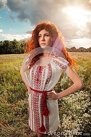http://thumbs.dreamstime.com/x/beautiful-red-haired-woman-ukrainian-national-dress-sunset-back-light-47504277.jpg