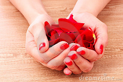 Beautiful red manicure and flower Stock Photo