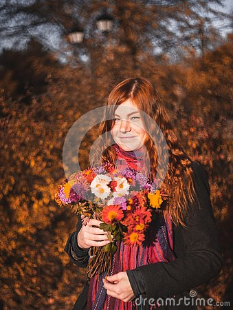 Free Beautiful Redhaired Girl With A Flowers. Stock Photography - 131275442