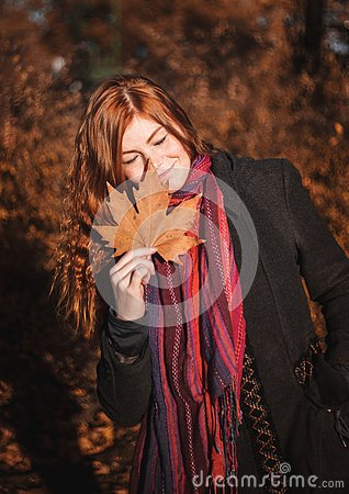 Free Beautiful Redhaired Girl With A Leaf. Stock Photography - 131275502