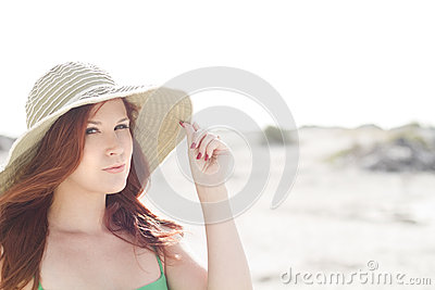 Beautiful redhead with a hat