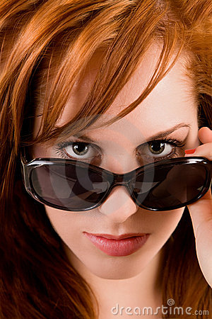 Beautiful Redhead Lady Looking Over Sunglasses