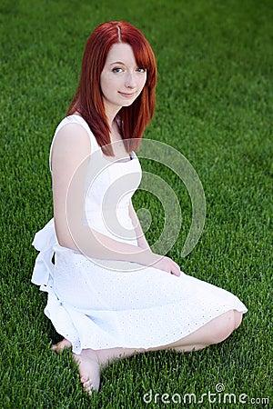 Beautiful redhead teen girl in white dress