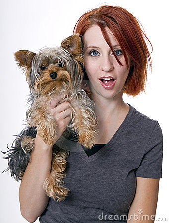 Beautiful redhead woman with family pet dog