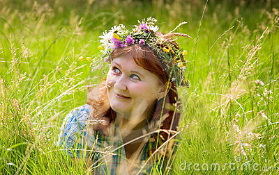 Beautiful redheaded woman in a flower wreath