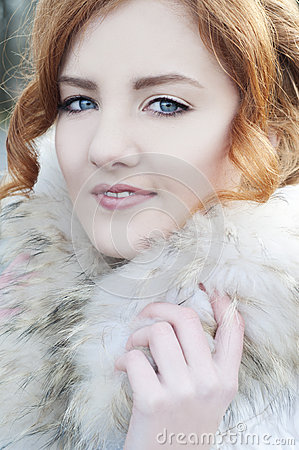 Beautiful redheaded woman in fur coat