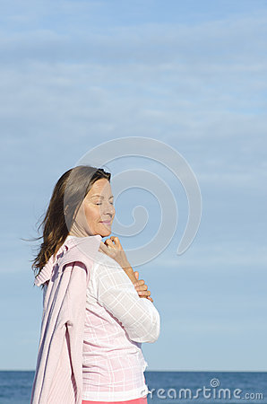 Beautiful relaxed senior woman ocean background