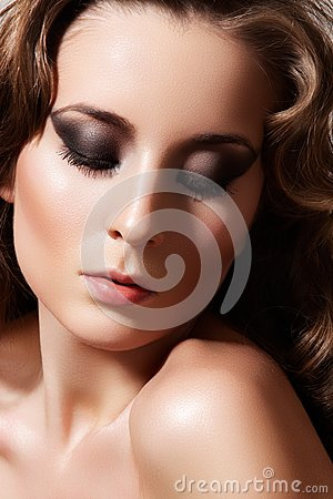 Beautiful retro diva. Evening make-up, curly hair