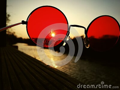A beautiful river trough red glasses royalty free stock photography