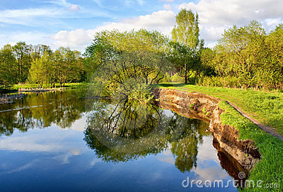 Beautiful riverside view with clouds and trees