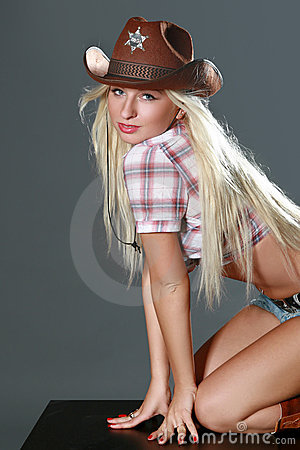 Beautiful rodeo cowgirl in cowboy hat