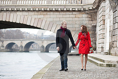 Beautiful romantic couple on a Parisian embankment