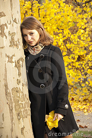 Beautiful romantic young girl in an autumn park