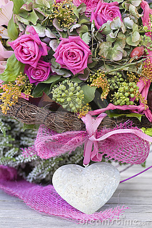 Beautiful roses arrangement with a stone heart