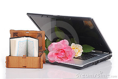 Beautiful roses laptop and Islam holy book put t