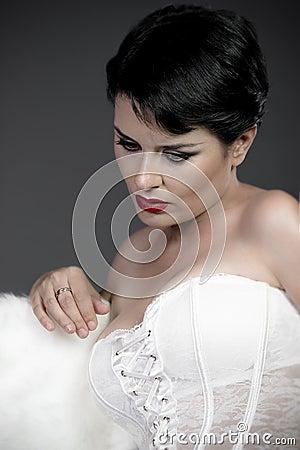 Beautiful sad bride with white corset