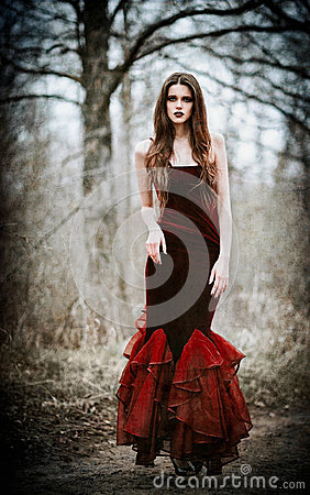 Free Beautiful Sad Girl In The Autumnal Forest. Grunge Texture Effect Stock Photo - 97833820