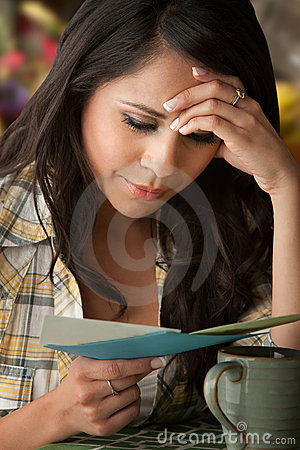 Beautiful Sad Latina Woman with Sympathy Card