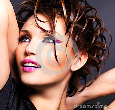 Beautiful saxy woman with bright pink makeup