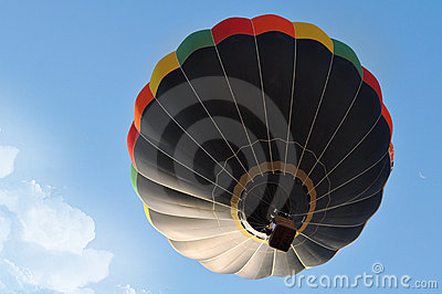 Beautiful scene with a black hot air balloon