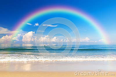 Beautiful sea with a rainbow in the sky Stock Photo