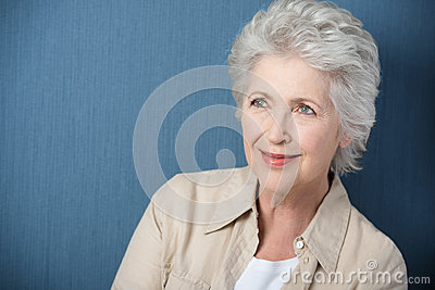 Beautiful senior woman daydreaming