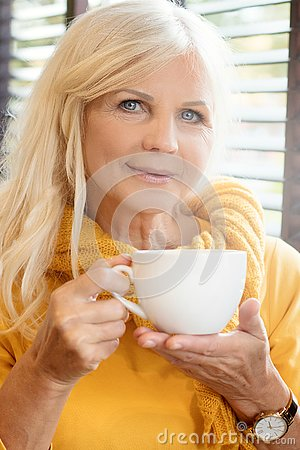 Free Beautiful Senior Woman Drinking Cofee. Stock Images - 130345374