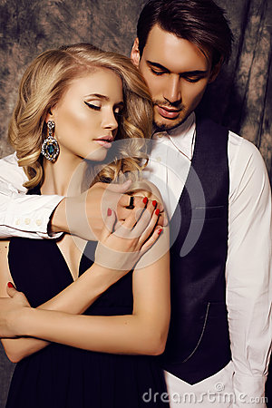Free Beautiful Sensual Couple In Elegant Clothes Posing In Studio Royalty Free Stock Image - 53587716